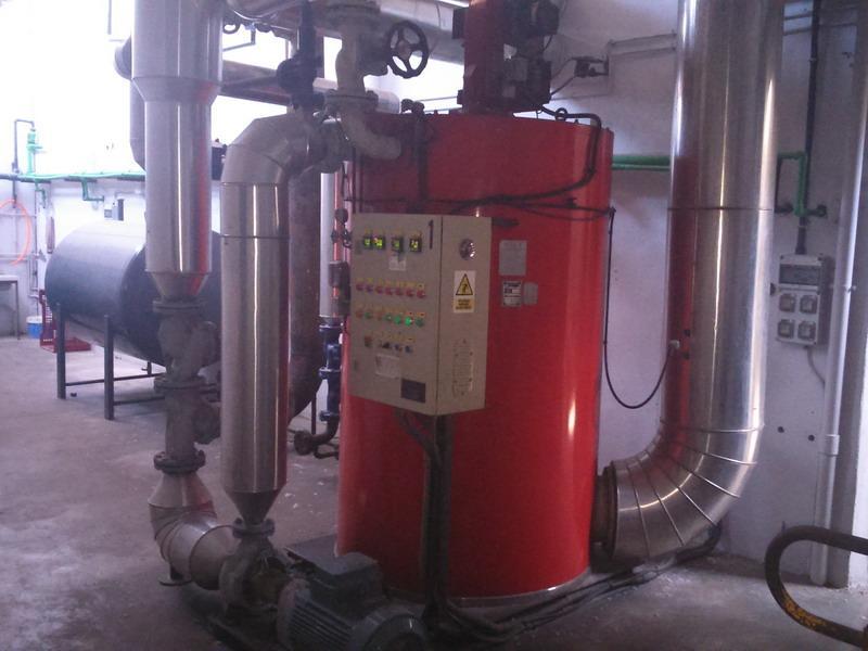 Caldera de aceite térmico con quemador de gasoil de 500.000 kcal en lavandería